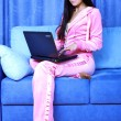 Woman working with PC at home in sofa — Photo
