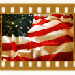 Vintage 35mm with old USA flag — Stock Photo