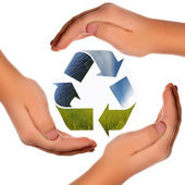 Recycling symbol in hands — Stock Photo
