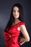 Young woman in red dress — Stok fotoğraf