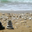 Pebble stack on the seashore - Stock Photo