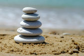 Pebble stack on the seashore — Stock Photo