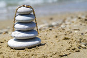 Pebble stack with watch on the seashore — Stock Photo