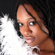 Afro-american woman with feather — Stock Photo