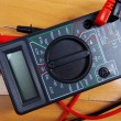 Stock Photo: Multimeter at table
