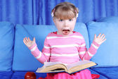 Surprised girl with apple and book — Stock Photo