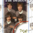 Foto Stock: Stamp with famous group Beatles