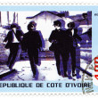 Stock Photo: Stamp with famous group of Beatles