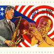 Stock Photo: Stamp Bill Clinton and Louis Armstrong