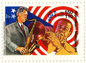 Stamp Bill Clinton and Louis Armstrong — Stock Photo