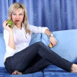 Stock Photo: Girl with apple and phone in room