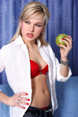 Girl with apple in room — Stok fotoğraf