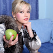 Girl with apple in room - 图库照片