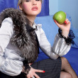 Girl with apple in room — Stock Photo #2581953