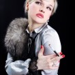Girl with fur and cigarette — Stock Photo
