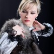 Girl with fur — Stock Photo