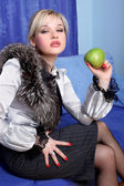 Girl with apple in room — Stock Photo