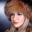 Woman in winter fur hat — Stock Photo #2592747