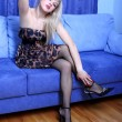 Young blondie girl in sofa — Stockfoto #2593411