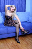 Young blondie girl in sofa — Стоковое фото