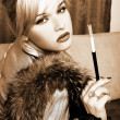 Stock Photo: Girl with fur and cigarette