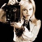 Blonde with retro photo camera — Stock Photo #2608641