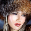 Woman in winter fur hat - Stock Photo