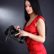Woman in red dress with clutch bag — Stock Photo #2647261