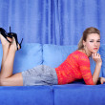 Woman relaxing in sofa — Stock Photo #2647749