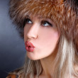 Blowing woman in winter fur hat — Stock Photo #2674532