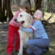 Stock Photo: Friends - children with retriever