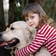 Little girl with big retriever — Stock Photo