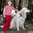 Friends - little girl with big retriever — Stock Photo