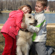 Children with retriever — Stock Photo