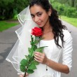 Bride in white dress with red flower — Stock Photo #2678972