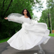 Flying bride in white dress — Stock Photo