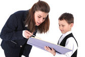 Teacher and boy with book — Stock Photo