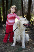 Little girl with retriever outd — Stock Photo