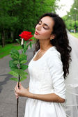 Bride with flower at road — Stock Photo