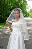 Bride in white dress at road outdoors — Stock Photo