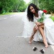Beautiful bride at the road — Stock Photo #2680071