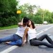 Two girs at road — Stock Photo