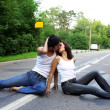 Stock Photo: Two girs at road