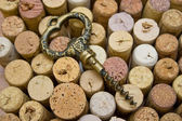Stoppers and old corkscrew. — Stock Photo