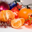 Christmas decoration and mandarine — Stock Photo #1042274