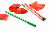 Marker and petals of poppy — Stock Photo
