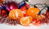 Christmas decoration and mandarine — Stock Photo