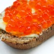 Sandwich with salmon caviar and butter — Stock Photo #1075008