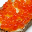 Sandwich with salmon caviar and butter — Stock Photo