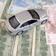 Stock Photo: Silvery car on euro and dollars